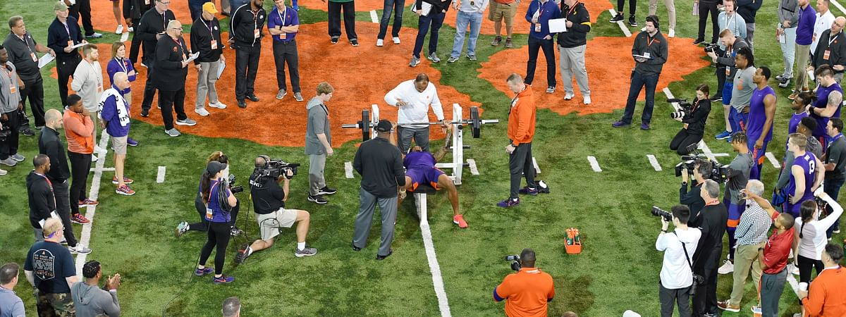 Clemson football player Tee Higgins lifts weights during NFL Pro Day Thursday, March 12, 2020, in Clemson, S.C.