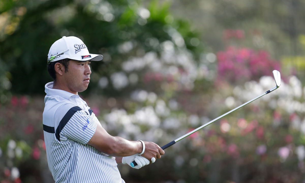 Hideki Matsuyama of Japan, follows his shot from the 13th tee, during the first round of The Players Championship golf tournament Thursday, March 12, 2020 in Ponte Vedra Beach, Florida.