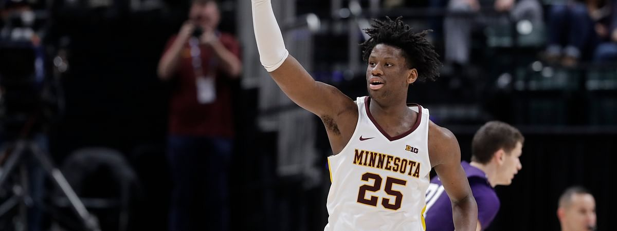 Minnesota's Daniel Oturu (25) reacts during the second half of an NCAA college basketball game against Northwestern at the Big Ten Conference tournament, Wednesday, March 11, 2020, in Indianapolis. Minnesota won 74-57.