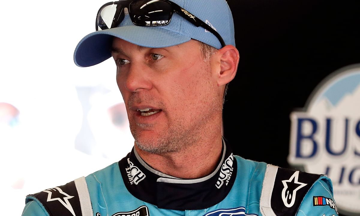 Kevin Harvick talks with crew members in his garage after a practice session for the NASCAR Daytona 500 auto race at Daytona International Speedway, Saturday, Feb. 15, 2020, in Daytona Beach, Florida.