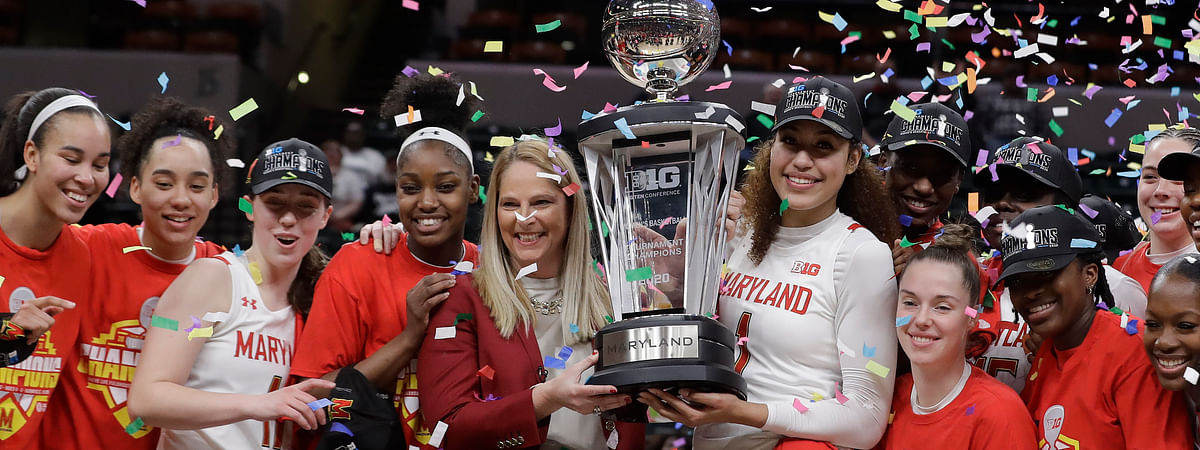 Maryland head coach Brenda Frese, center, celebrates with her team after Maryland defeated Ohio State, 82-65, to win NCAA college basketball championship game at the Big Ten Conference tournament, Sunday, March 8, 2020, in Indianapolis.