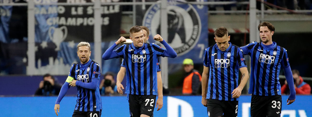 In this Wednesday, Feb. 19, 2020 file photo, Atalanta's Josip Ilicic, second left, celebrates with teammates after scoring his side's second goal during the soccer match between Atalanta and Valencia at the San Siro stadium in Milan, Italy. More than a month later, experts are pointing to the Feb. 19 game as one of the biggest reasons why Bergamo has become one of the epicenters of the coronavirus pandemic and why 35% of Valencia's team became infected.