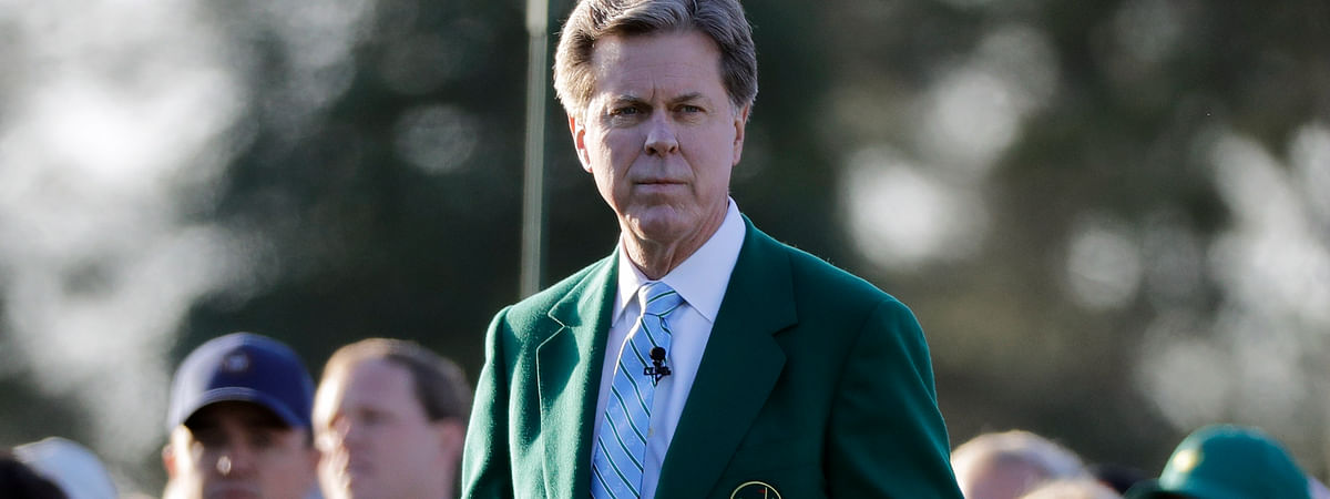 FILE - In this April 5, 2018, file photo, Augusta National Golf Club Chairman Fred Ridley watches the honorary first tee shots before the first round at the Masters golf tournament in Augusta, Ga. Augusta National decided Friday, March 13, 2020, to postpone the Masters because of the spread of the coronavirus. Club chairman Fred Ridley says he hopes postponing the event puts Augusta National in the best position to host the Masters and its other two events at some later date. Ridley did not say when it would be held.(AP Photo/David J. Phillip, File)