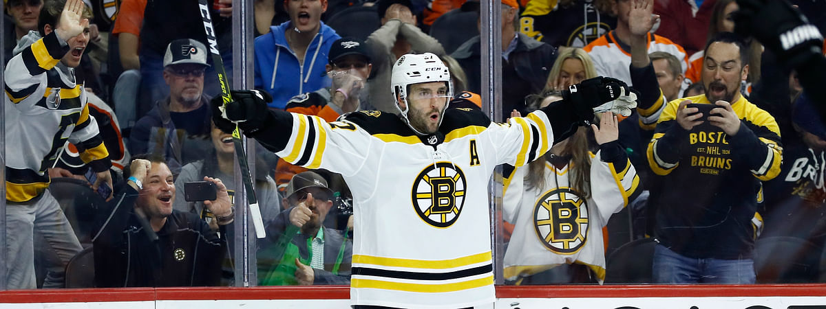 Boston Bruins' Patrice Bergeron celebrates after scoring a goal during the third period of an NHL hockey game against the Philadelphia Flyers, Tuesday, March 10, 2020, in Philadelphia. Boston won 2-0. (AP Photo/Matt Slocum)