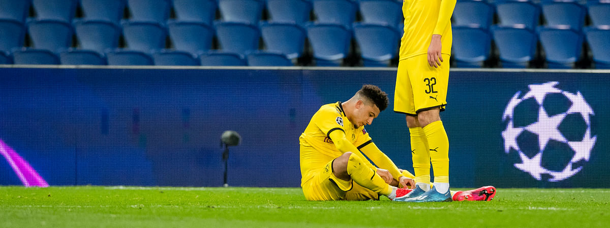 Borussia Dortmund's Jason Sancho and Giovanni Reyna, right, react after Paris Saint Germain's victory at the end of the Champions League round of 16 second leg soccer match between PSG and Borussia Dortmund, Wednesday March 11, 2020 in Paris. The match is being played in an empty stadium because of the coronavirus outbreak.