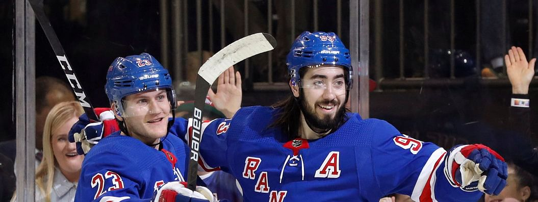 New York Rangers center Mika Zibanejad (93) celebrate one of his five goals against the Capitals on March 5 (Kathy Willens)