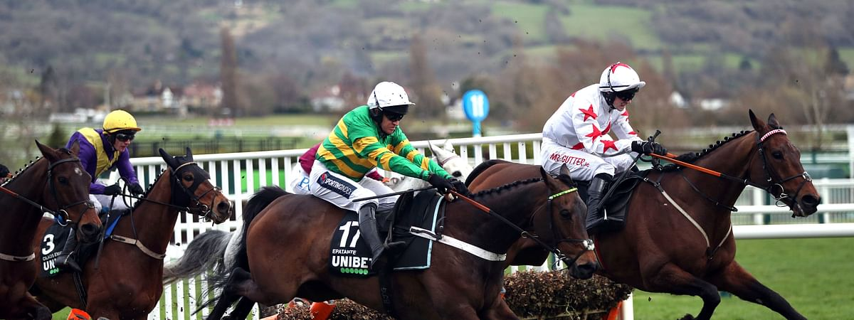 Barry Geraghty, jockey of Epatante, second right, goes on to win the Champion Hurdle on day one of the Cheltenham Festival at Cheltenham Racecourse, Cheltenham, England, Tuesday, March 10, 2020.