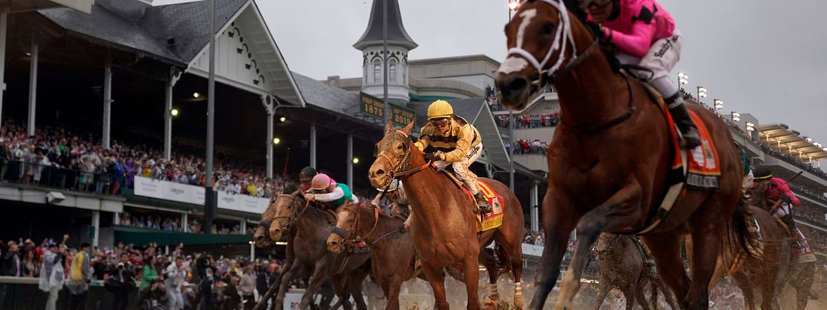In this May 4, 2019, file photo, Luis Saez rides Maximum Security, right, across the finish line first against Flavien Prat on Country House during the 145th running of the Kentucky Derby horse race at Churchill Downs in Louisville, Ky. Citing unidentified sources close to the race, the Courier-Journal of Louisville said Churchill Downs will postpone the Derby from May 2, 2020, to Sept. 5, making it the first time in 75 years that the race won't be run on the first Saturday in May.