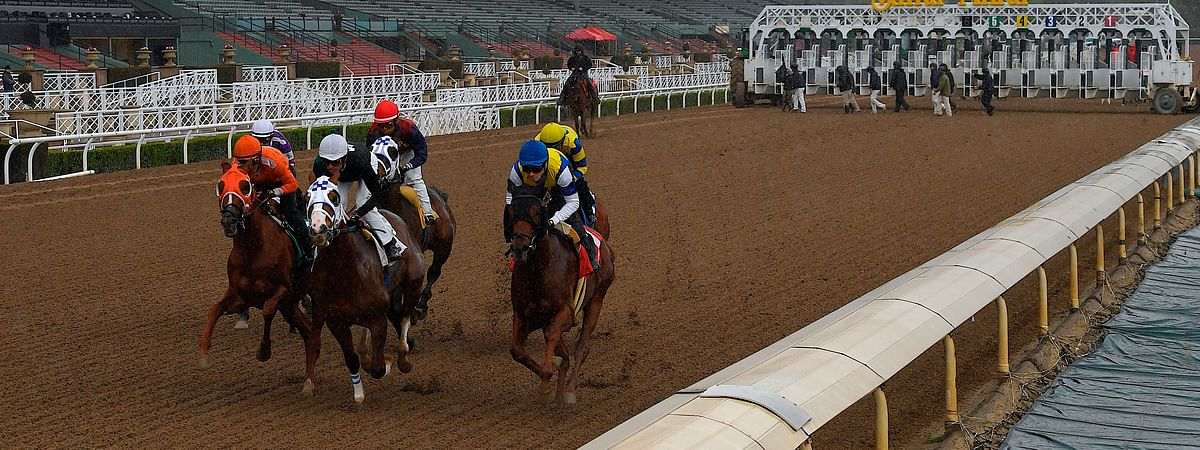 Horses run in the fourth race at Santa Anita Park in front of empty stands, Saturday, March 14, 2020, in Arcadia, Calif. While most of the sports world is idled by the coronavirus pandemic, horse racing runs on.