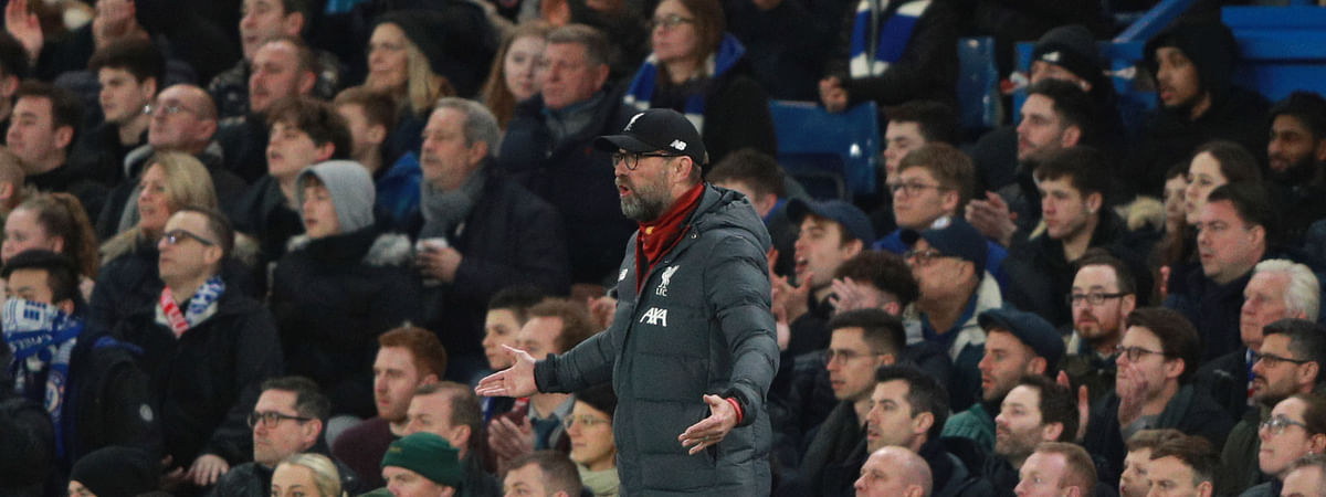 Liverpool's manager Jurgen Klopp shouts out from the touchline during the English FA Cup fifth round soccer match between Chelsea and Liverpool at Stamford Bridge stadium in London Tuesday, March 3, 2020.