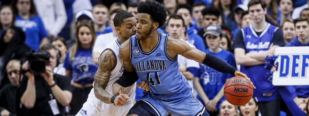 In this March 4, 2020 file photo, Villanova's Saddiq Bey (41) drives against Seton Hall's Shavar Reynolds, left, during the second half of an NCAA college basketball game.