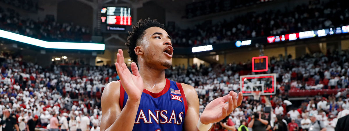 In this March 7, 2020, file photo, Kansas' Devon Dotson (1) celebrates after an NCAA college basketball game against Texas Tech in Lubbock, Texas. Kansas finished the season No. 1 in The Associated Press college basketball poll, receiving 63 of 65 first-place votes from a national media panel Wednesday, March 18, 2020.