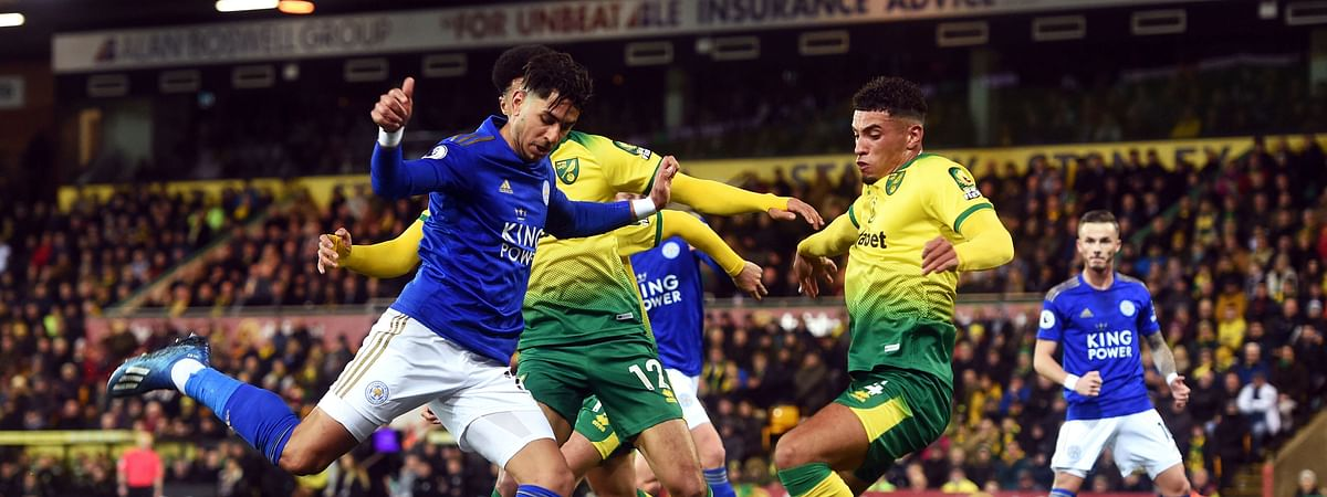 Leicester City's Ayoze Perez, left, and Norwich City's Ben Godfrey battle for the ball during the English Premier League soccer match at Carrow Road, Norwich, Friday Feb. 28, 2020.