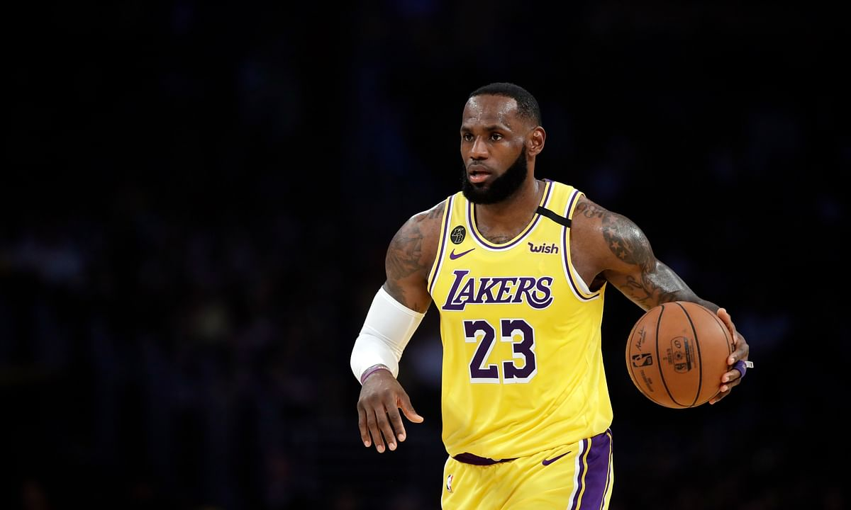 Los Angeles Lakers' LeBron James (23) dribbles during the first half of an NBA basketball game against the Brooklyn Nets Tuesday, March 10, 2020, in Los Angeles.