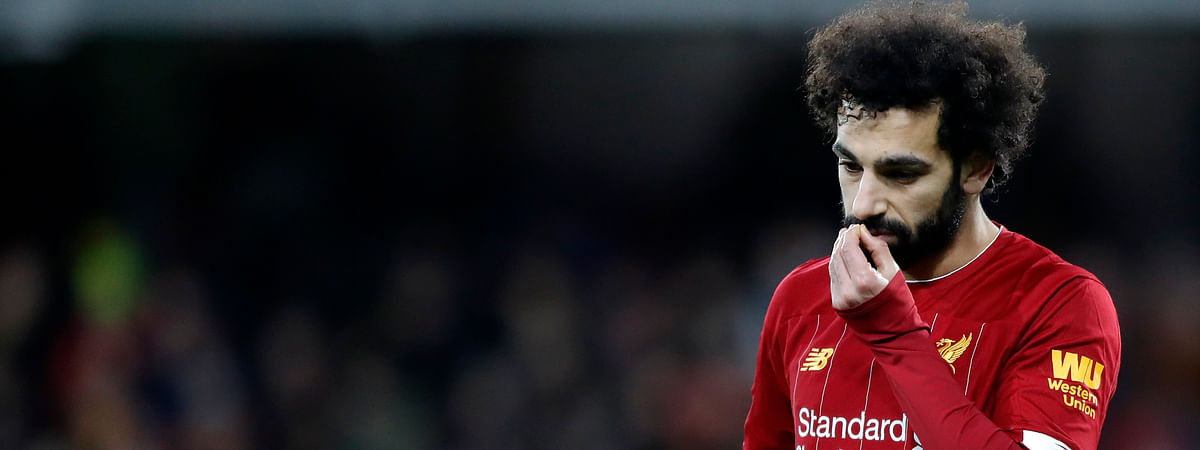 Liverpool's Mohamed Salah leaves the field at the end of the English Premier League soccer match between Watford and Liverpool at Vicarage Road stadium, in Watford, England, Saturday, Feb. 29, 2020. The match finished 3-0.