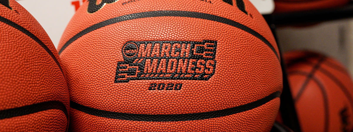 Official March Madness 2020 tournament basketballs are seen in a store room at the CHI Health Center Arena, in Omaha, Neb., Monday, March 16, 2020. Omaha was to host a first and second round in the NCAA college basketball Division I tournament, which was cancelled due to the coronavirus pandemic.