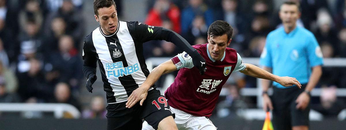 Burnley's Jack Cork (right) battles Newcastle United's Javier Manquillo for the ball on Feb. 29 (Owen Humphreys/PA via AP