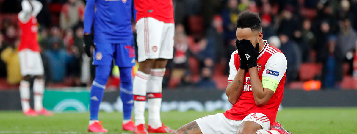 Arsenal's Pierre-Emerick Aubameyang reacts after losing the Europa League round of 32, second leg, soccer match between Arsenal and Olympiakos at Emirates stadium in London, England, Thursday, Feb. 27, 2020.