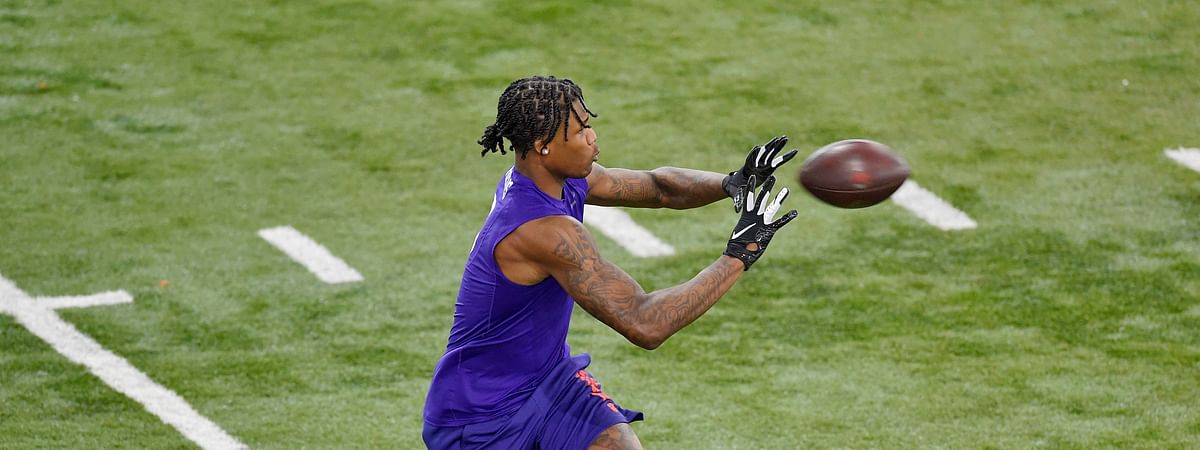 Clemson football player Tee Higgins catches a pass while running drills during NFL Pro Day Thursday, March 12, 2020, in Clemson, S.C. Will he be a first-round NFL Draft pick? Mark Eckel thinks so.