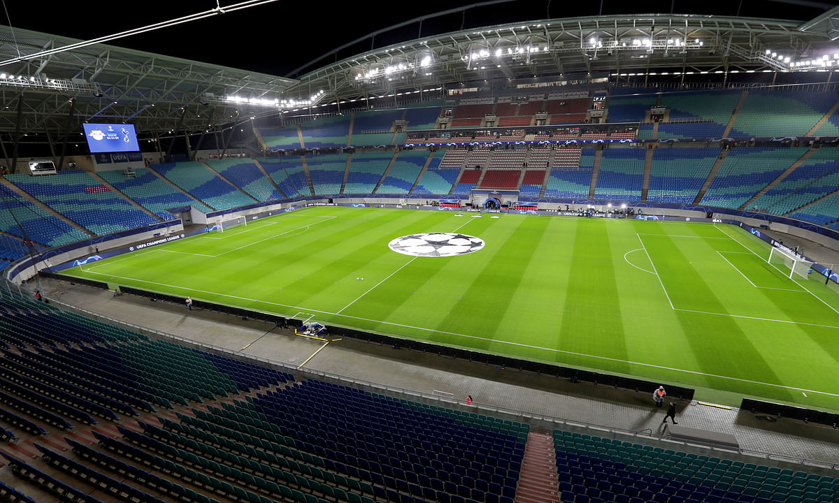 In this Tuesday, March 10, 2020 photo the empty stadium is pictured prior to the Champions League round of 16, 2nd leg soccer match between RB Leipzig and Tottenham Hotspur in Leipzig, Germany.