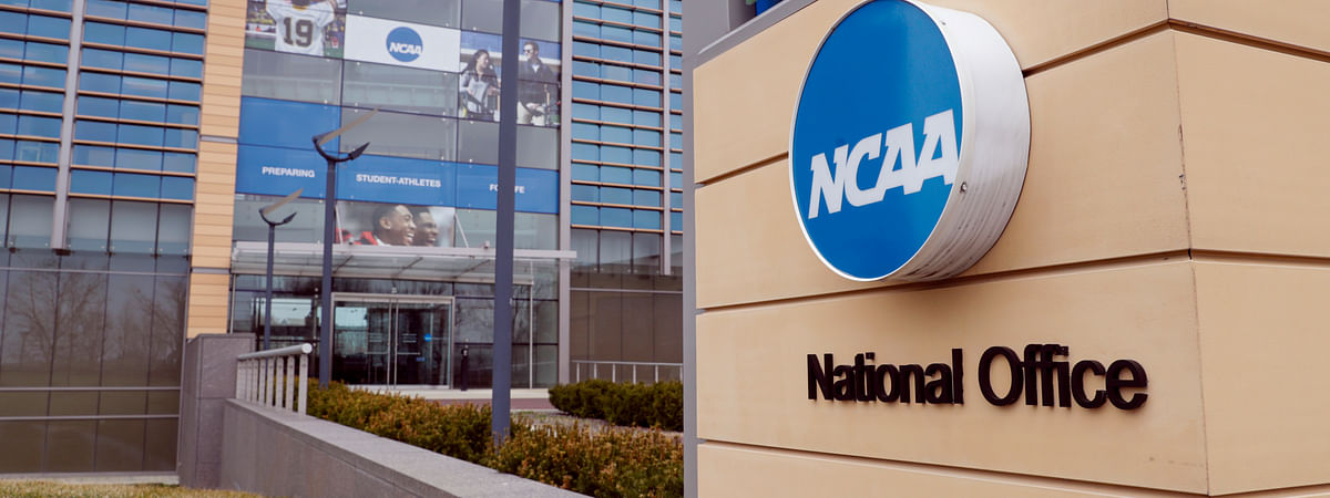In this March 12, 2020, file photo, The national office of the NCAA in Indianapolis is viewed. The NCAA Division I Council voted Monday, March 30, 2020, to give spring sport athletes regardless of their year in school a way to get back the season they lost, but did not guarantee financial aid to the current crop of seniors if they return to play next year.