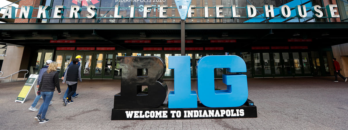 Fans enter The Bankers Life Fieldhouse for a game at the Big Ten Conference tournament in Indianapolis, Thursday, March 12, 2020.