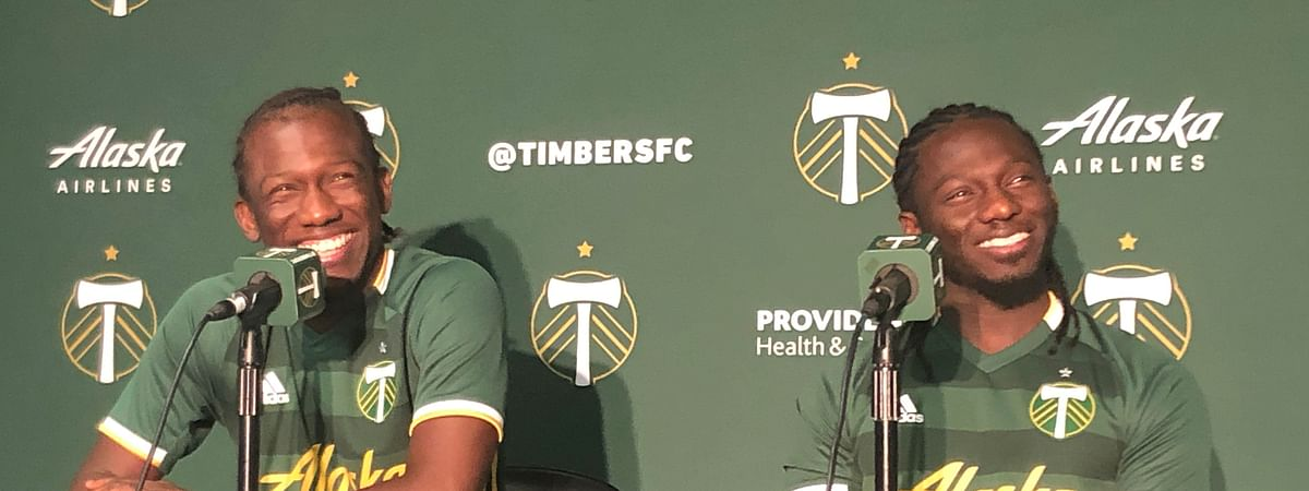 In this Jan. 22, 2020 photo, Diego Chara, left, and his younger brother Yimmi Chara, right, speak at the Portland Timbers' MLS soccer media day at Providence Park in Portland, Ore. The brothers are playing together for the Portland Timbers this season. (AP Photo/Anne M. Peterson)
