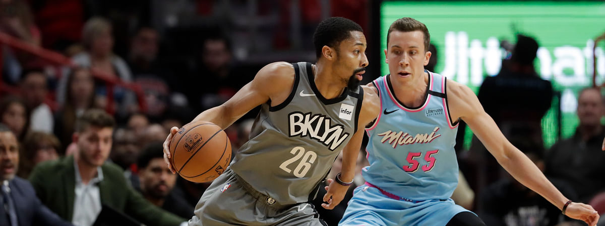 Brooklyn Nets guard Spencer Dinwiddie (26) drives up against Miami Heat forward Duncan Robinson (55) during the first half of an NBA basketball game, Saturday, Feb. 29, 2020, in Miami.