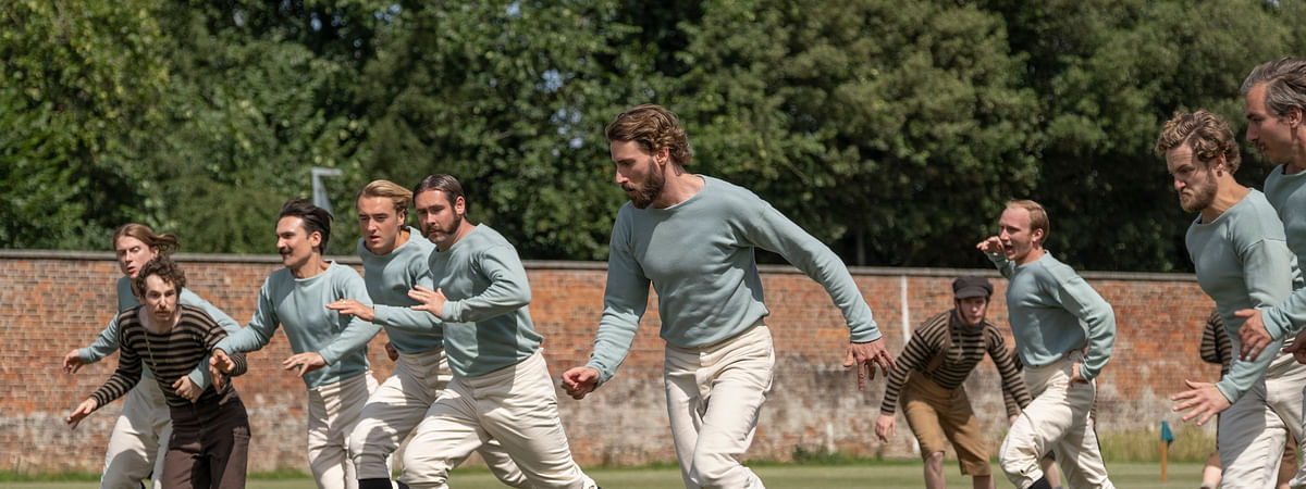 "This image released by Netflix shows Edward Holcroft, foreground, in a scene from ""The British Game,"" a six-part drama charting the origins of soccer."