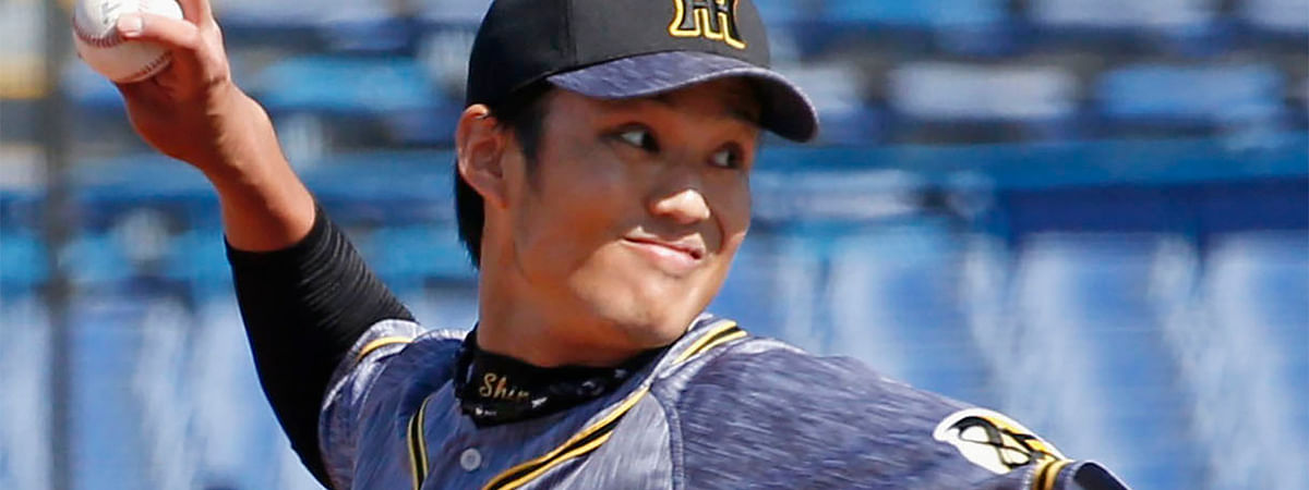 In this March 11, 2020, photo, Hanshin Tigers pitcher Shintaro Fujinami throws a ball against Yakult Swallows in a pre-season match in Tokyo. Fujinami became the first professional baseball player in Japan to test positive for the new coronavirus. Fujinami was examined at a hospital and a doctor recommended he have a PCR test for the new coronavirus. Kyodo News agency reported on Friday, March 27, that the result was positive.