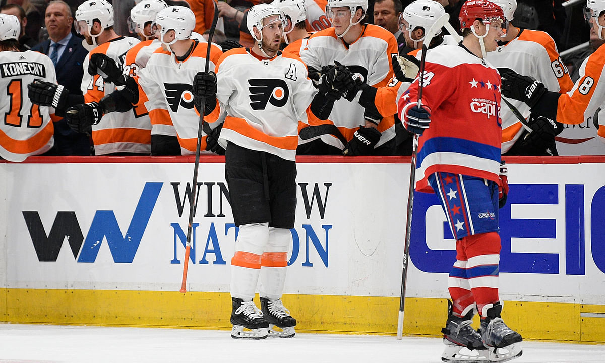 Flyers center Kevin Hayes celebrates his goal as Washington Capitals defenseman John Carlson skates nearby March 4 (Nick Wass)