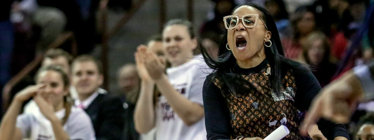 FILE - In this Jan. 2, 2020, file photo, South Carolina coach Dawn Staley disputes a call during the second half of an NCAA college basketball game against Kentucky in Columbia, S.C. Staley was announced as The Associated Press women's basketball coach of the year Monday, March 23, 2020. (Tracy Glantz/The State via AP, File)