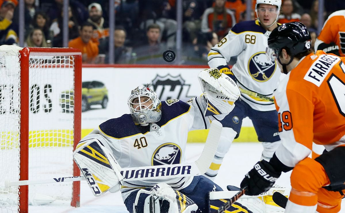Flyers Joel Farabee looks on as Sabres goalie Carter Hutton makes a second-period save on March 7; Farabee would later score a milestone third-period goal