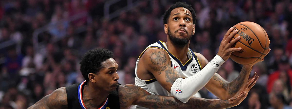 Denver Nuggets guard Monte Morris, right, moves to the basket as Los Angeles Clippers guard Lou Williams defends during the first half of an NBA basketball game Friday, Feb. 28, 2020, in Los Angeles.
