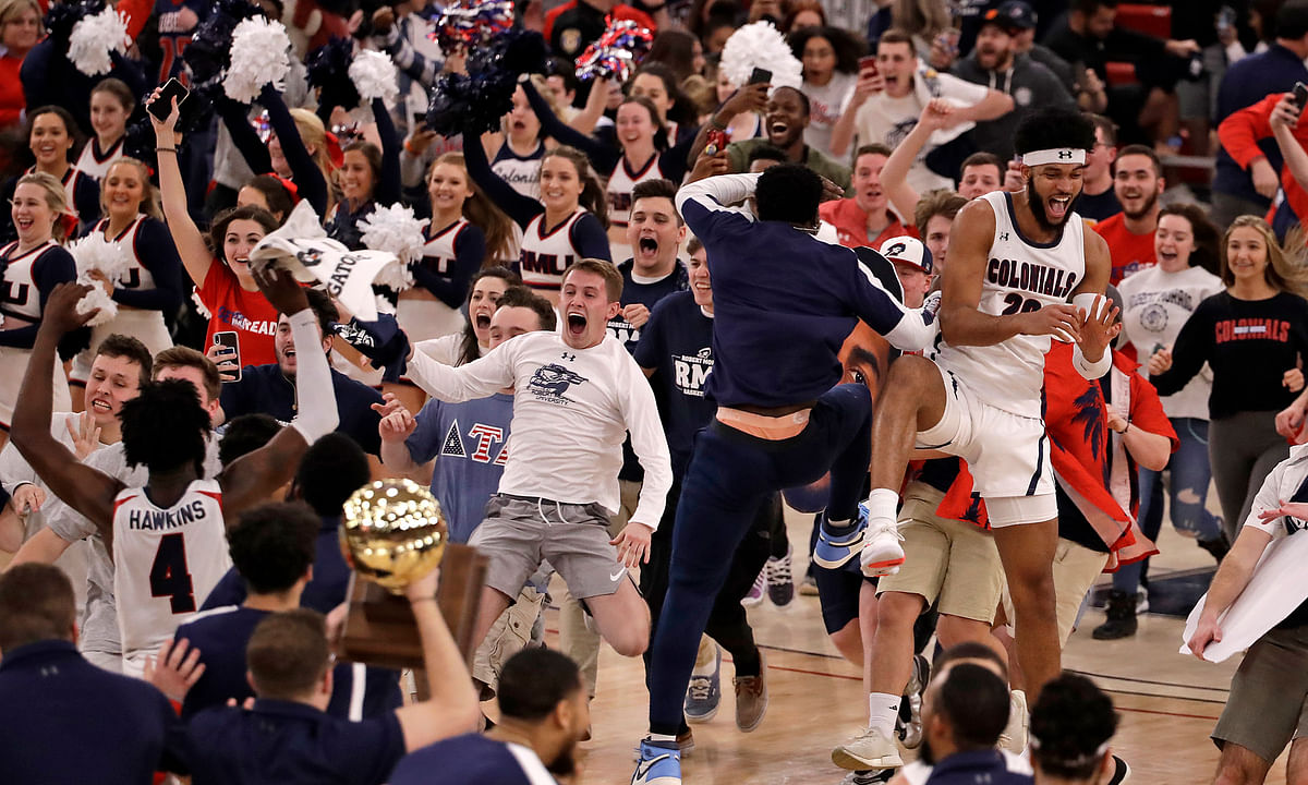 Robert Morris fans run onto the court as the team celebrates following a 77-67 win over St. Francis in an NCAA college basketball game for the Northeast Conference men's tournament championship in Pittsburgh, Tuesday, March 10, 2020. (AP Photo/Gene J. Puskar)