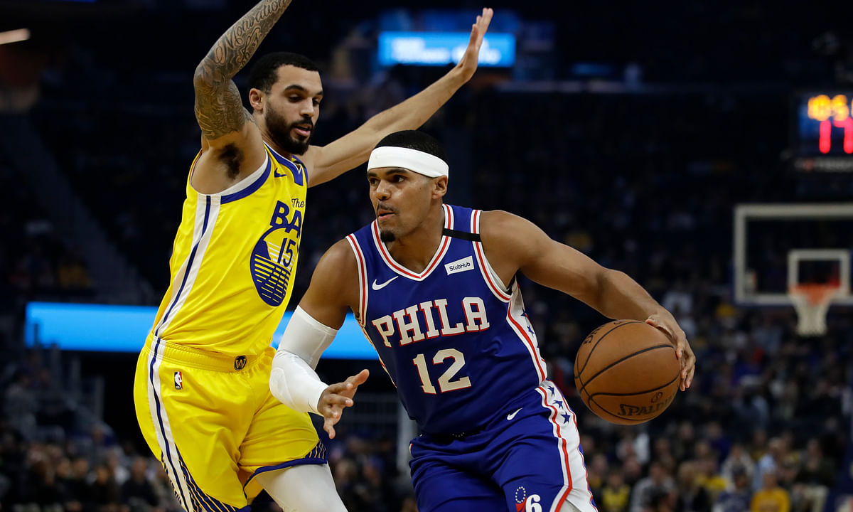 Philadelphia 76ers' Tobias Harris (12) drives the ball against Golden State Warriors' Mychael Mulder, left, during the first half of an NBA basketball game Saturday, March 7, 2020, in San Francisco.