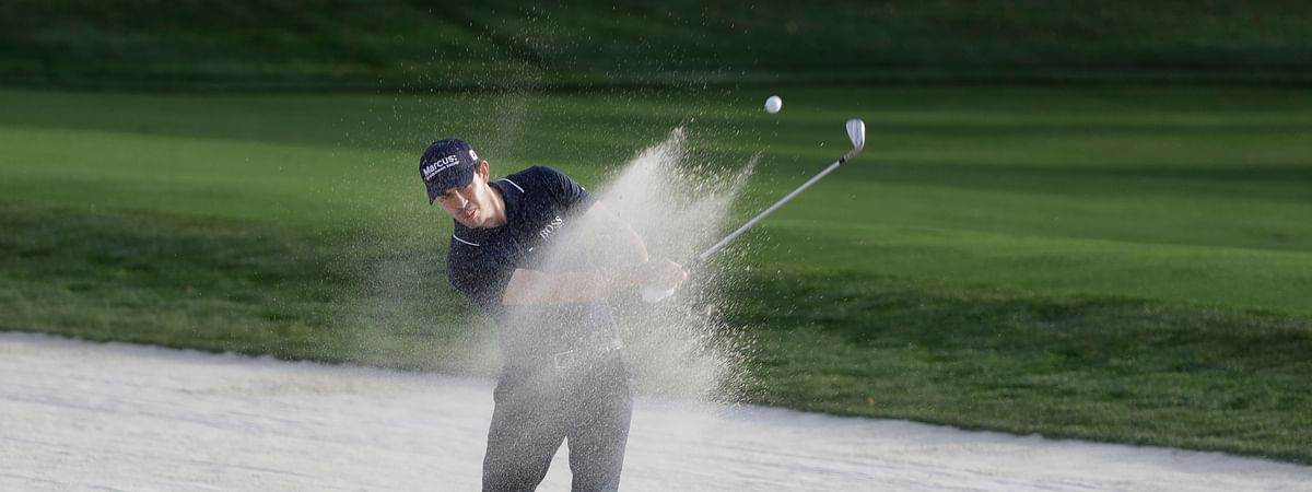 Patrick Cantlay hits onto the 11th green, during the first round of The Players Championship golf tournament Thursday, March 12, 2020, in Ponte Vedra Beach, Florida.