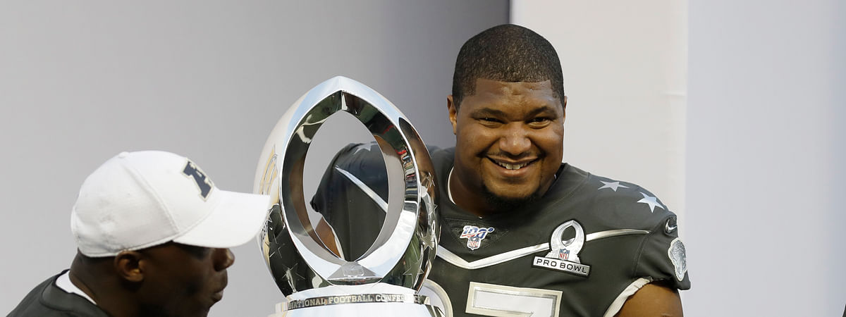 AFC defensive end Calais Campbell, of the Jacksonville Jaguars, (93) holds the Pro Bowl trophy after the NFL Pro Bowl football game, Sunday, Jan. 26, 2020, in Orlando, Fla. The AFC defeated the NFC 38-33. Campbell won the MVP defensive player of the game.