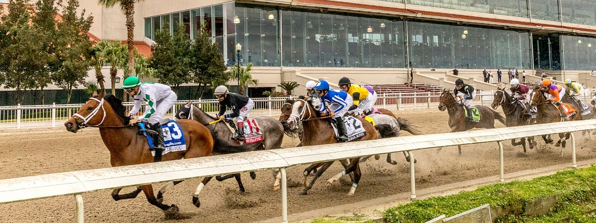 Wells Bayou, left, ridden by jockey Florent Geroux, took an early lead and held off NY Traffic to win he 107th running of the $1,000,000 Grade II Louisiana Derby horse race, Saturday, March 21, 2020, at a fanless Fair Grounds race course in New Orleans.