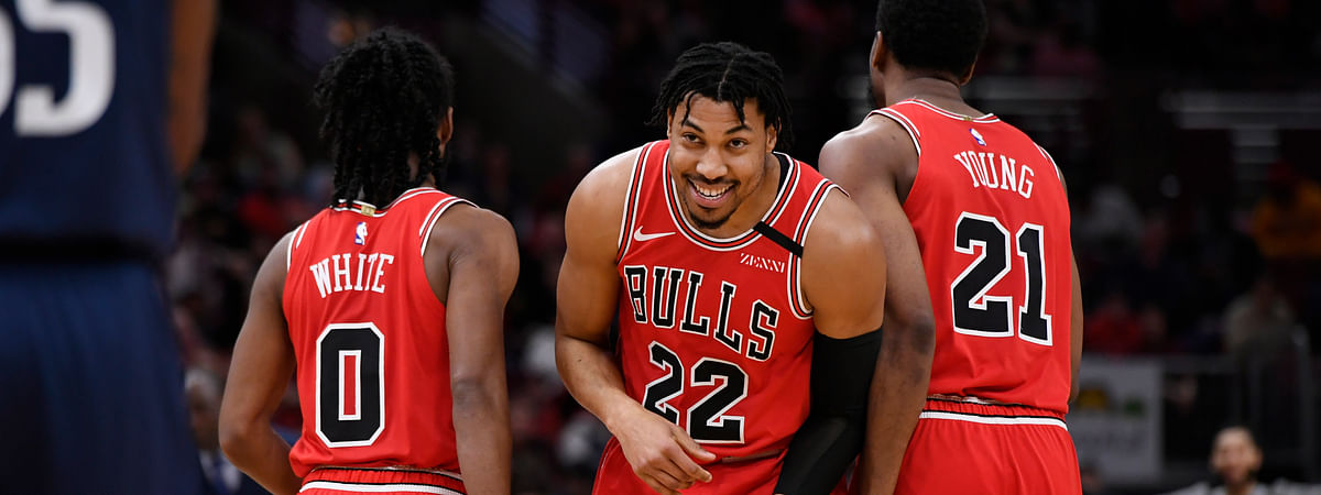 Chicago Bulls' Otto Porter Jr. (22) celebrates with teammates Coby White (0) and Thaddeus Young (21) after being fouled while making a basket during the second half of an NBA basketball game against the Dallas Mavericks, Monday, March 2, 2020, in Chicago. (AP Photo/Paul Beaty)
