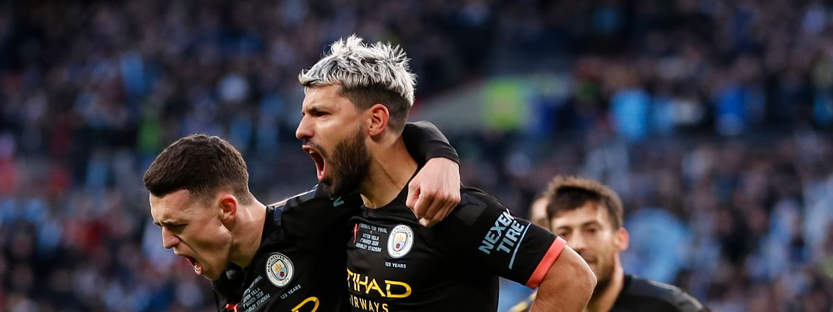 Manchester City's Sergio Aguero, right, celebrates with his teammate Phil Foden after scoring his side's first goal during the League Cup soccer match final between Aston Villa and Manchester City, at Wembley stadium, in London, England, Sunday, March 1, 2020.