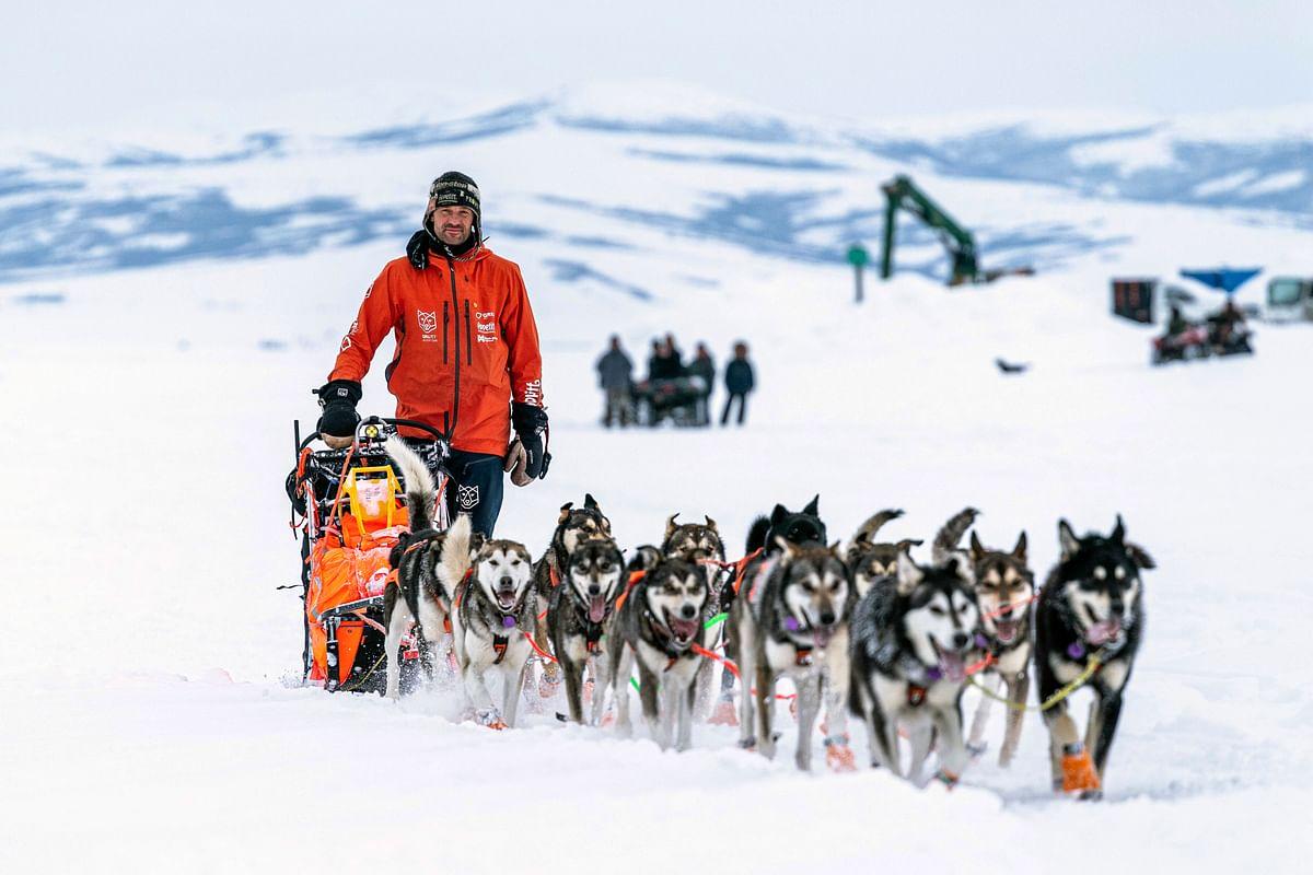 Thomas Waerner mushes into Unalakleet, Alaska, Sunday, March 15, 2020 during the Iditarod Trail Sled Dog Race.