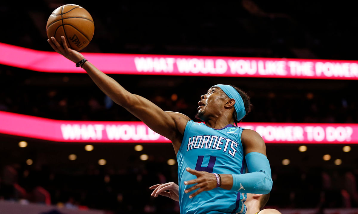 Hornets guard Devonte' Graham drives to the basket against the Nuggets March 5 (Nell Redmond)