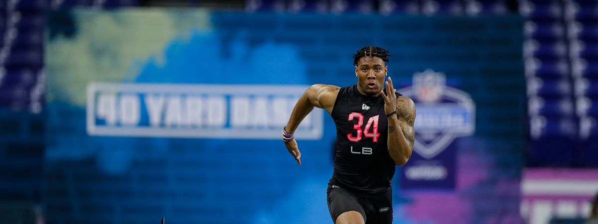 Clemson linebacker Isaiah Simmons runs the 40-yard dash at the NFL football scouting combine in Indianapolis, Saturday, Feb. 29, 2020. (AP Photo/Michael Conroy)