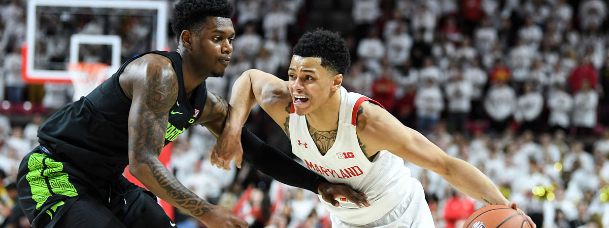 Maryland guard Anthony Cowan Jr. (1) drives to the basket against Michigan State guard Rocket Watts (2) during the second half of an NCAA college basketball game Saturday, Feb. 29, 2020, in College Park, Md.