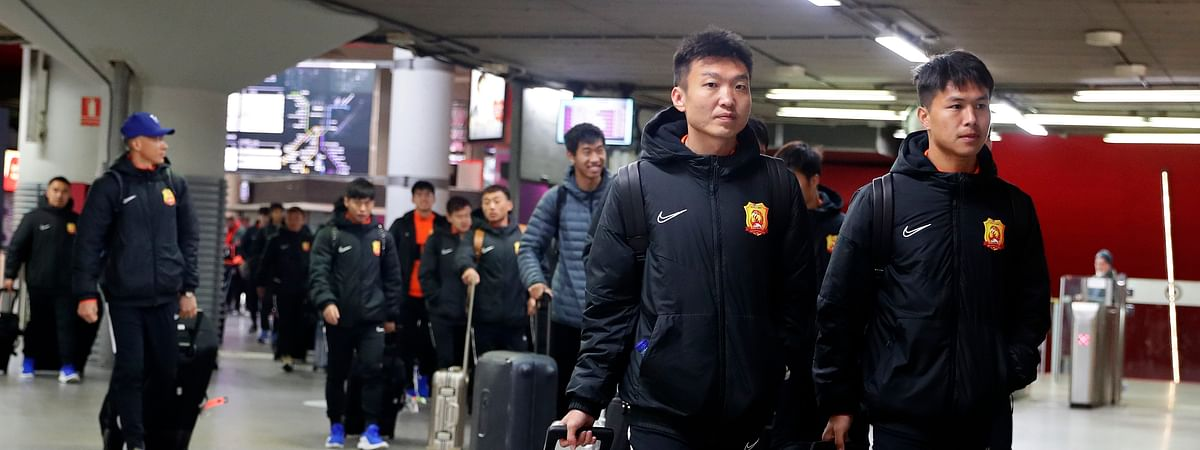 """Players of the Chinese Super League team Wuhan Zall arrive at the Atocha train station in Madrid, Spain, Saturday, Feb. 29, 2020. The Chinese first-division soccer club from the city of Wuhan enters its second month in Spain without knowing when it will be able to return home. . It hasn't been easy for the nearly 50 members of the Wuhan Zall squad, but on Sunday they will get some reprieve from their ordeal by attending the Spanish league """"clasico"""" between Real Madrid and Barcelona at the Santiago Bernabeu Stadium in Madrid. (AP Photo/Manu Fernandez)"""