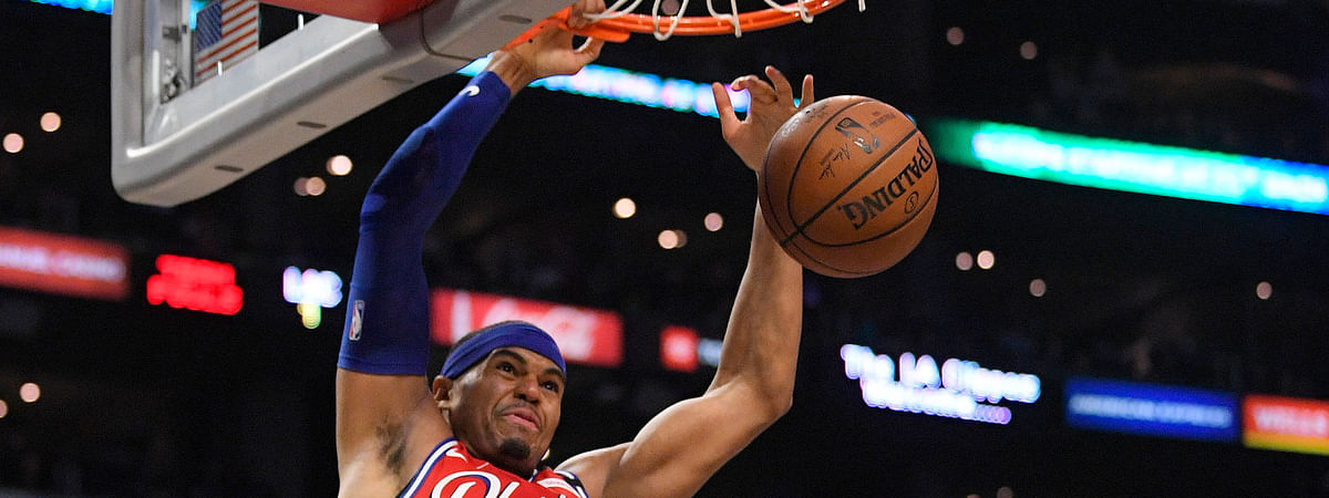 Sixers forward Tobias Harris dunks as Clippers guard Paul George looks on March 1 (Mark J. Terrill)