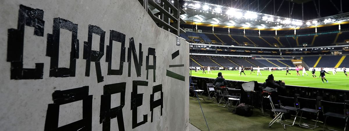 Eintracht fans have taped letters at a wall of the stadium during a Europa League round of 16, 1st leg soccer match between Eintracht Frankfurt and FC Basel in Frankfurt, Germany, Thursday, March 12, 2020. The match was played in an empty stadium because of the coronavirus outbreak.