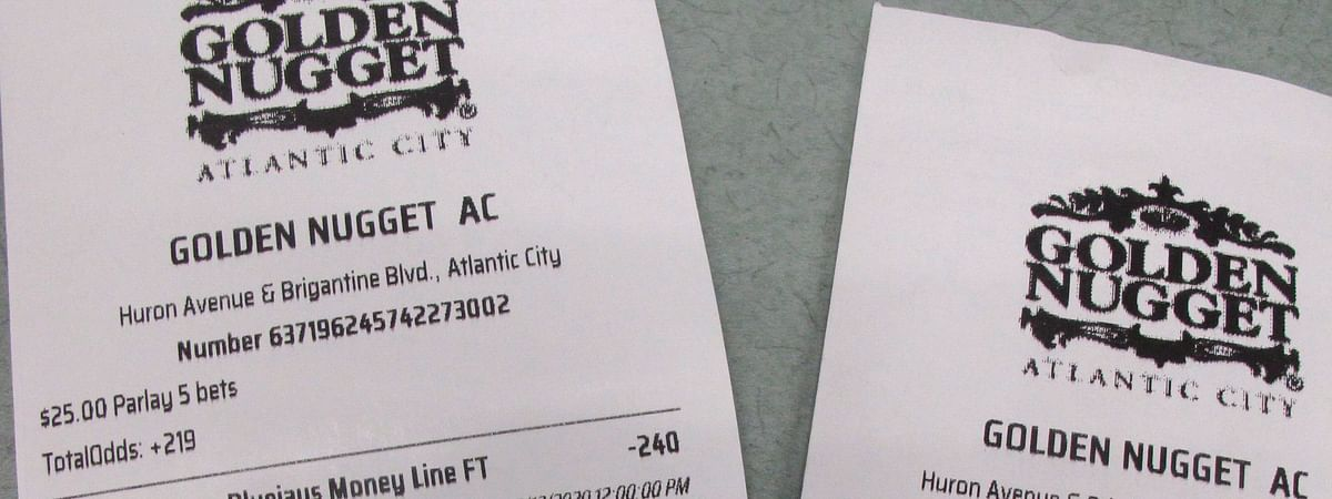 This March 12, 2020 shows a sports betting ticket at the Golden Nugget casino in Atlantic City, N.J. where all five games that were bet on were canceled due to coronavirus precautions. Most professional and college sports events in the U.S. have been suspended or delayed, leaving little to bet on. For most people, the new coronavirus causes only mild or moderate symptoms. For some it can cause more severe illness. (AP Photo/Wayne Parry)