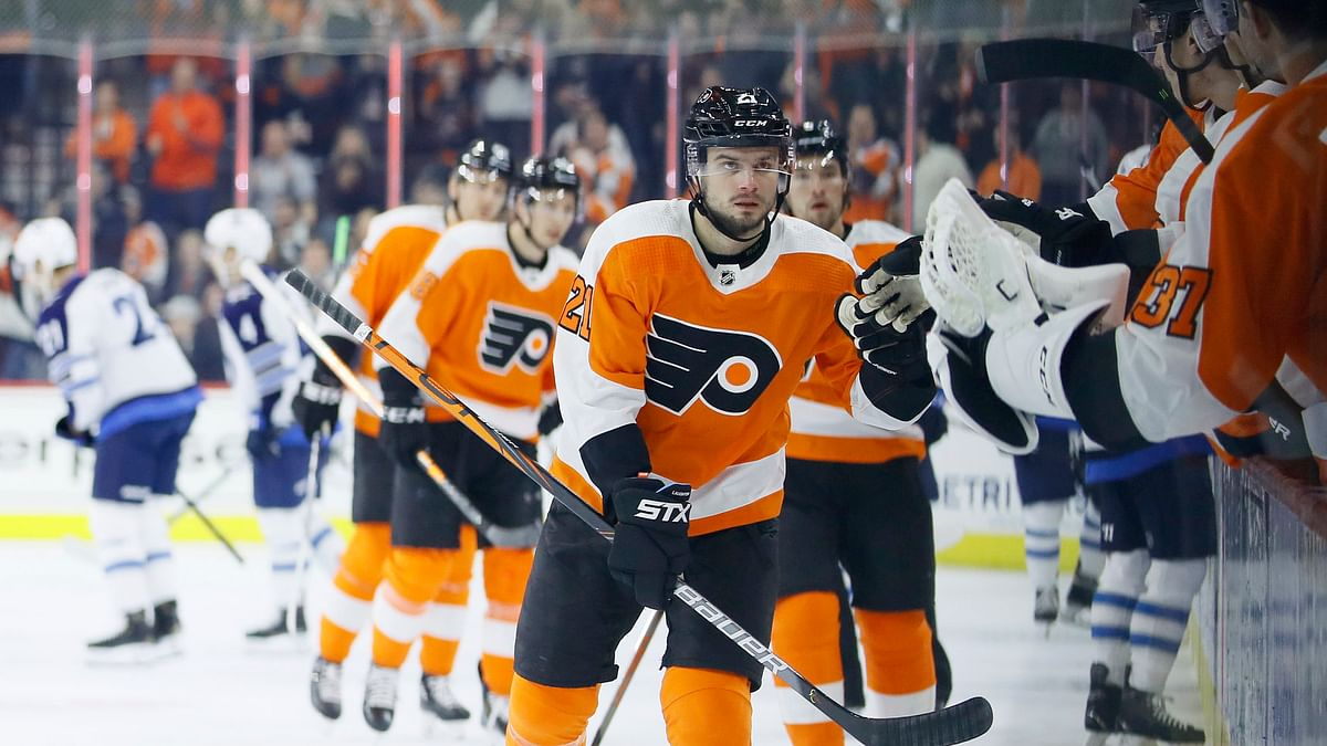 Scott Laughton skates by the Flyers' bench after scoring a goal in the first period against the Jets Feb.22 (Matt Slocum)